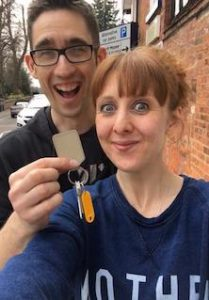 two people holding the keys to a house they've just bought in Wythenshawe, south Manchester